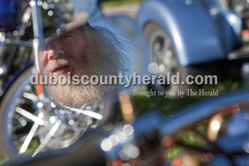 """Carlton """"The Wizzard"""" Kerby of West Baden hung out by his 1985 Harley Davidson FXWG customized bike during a bike show at the 30th annual ABATE of Indiana Region 10 Southern Hills Bash at the Ireland Sportsman Club on Saturday. Heather Rousseau/The Herald"""