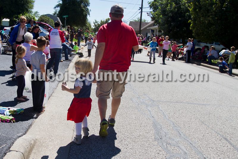 Todd Meyer and his daughter Anna, 5, at the Holland Community Festival Parade on Saturday.<br /> Caitlin O'Hara/The Herald