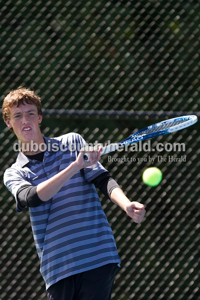Jasper's Logan Mathies played the No. 2 singles championship match against Castle's Anish Bedi during the Jasper Invitational on Saturday.<br /> Caitlin O'Hara/The Herald