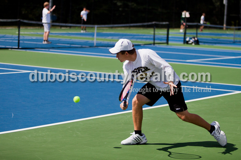 Jasper's Grant Weaver played the No. 1 singles championship match against Bloomington South's Will Piekarsky during the Jasper Invitational on Saturday.<br /> Caitlin O'Hara/The Herald