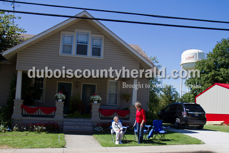 Virginia Thacker of Huntingburg, left, and daughter-in-law Vickie Thacker of Holland watched the Holland Community Festival parade at Vickie's home on Saturday. <br /> Caitlin O'Hara/The Herald