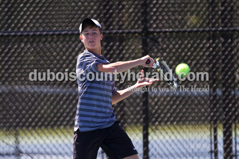 Jasper's Jo Kemker played in the No. 1 doubles championship match against Bloomington North during the Jasper Invitational on Saturday.<br /> Caitlin O'Hara/The Herald