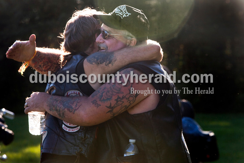 """Bryan Hughes of Bedford, left, was hugged by Henry Conway Jr. of Heather Rousseau/The Herald<br /> Mitchell after Mitchell threw a water balloon at him at the 30th annual ABATE of Indiana Region 10 Southern Hills Bash at the Ireland Sportsman Club on Saturday. The weekend gathering is one of many by the club that raises money for the Hoosier Burn Camp, a nonprofit organization that provides life-changing experiences for young people who have suffered the physical and emotional trauma associated with a severe burn injury. More photos are at  <a href=""""http://www.DuboisCountyHerald.com"""">http://www.DuboisCountyHerald.com</a>."""