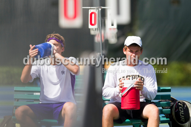 Jasper's Grant Weaver, right, and Bloomington South's Will Piekarsky, left, drank from their water bottles during the No. 1 singles championship match at the Jasper Invitational on Saturday.<br /> Caitlin O'Hara/The Herald