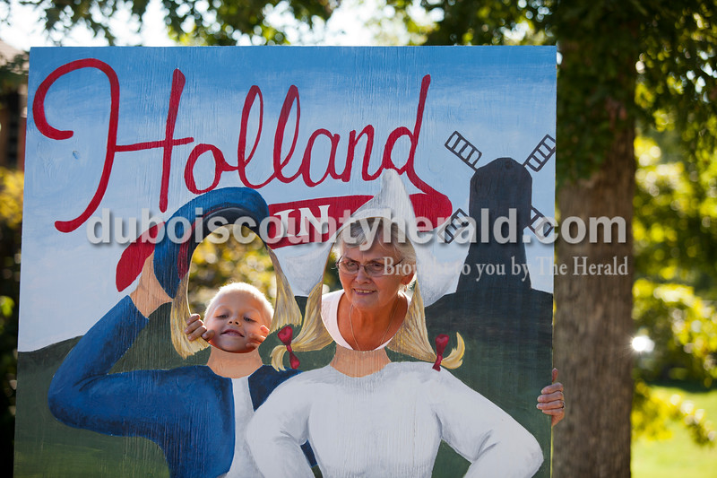 Case Reinke of Dale, 7, and his grandmother Judy Heilman of Santa Claus took a photo together at the Holland Community Festival on Saturday.<br /> Caitlin O'Hara/The Herald