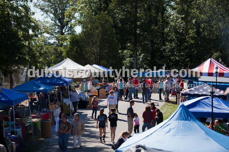 Attendees enjoyed booths selling food, arts and crafts during the Holland Community Festival on Saturday.<br /> Caitlin O'Hara/The Herald
