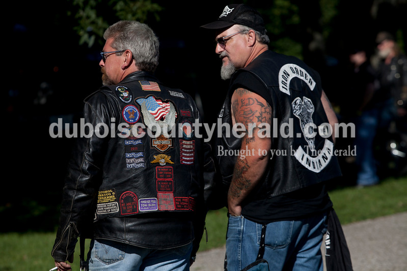 Heather Rousseau/The Herald<br /> Henry Conway of Mitchell, left, and Chris Bell Pein of Lawrence watched as motorcyclists approached for a bike show during the 30th annual ABATE of Indiana Region 10 Southern Hills Bash at the Ireland Sportsman Club on Saturday.