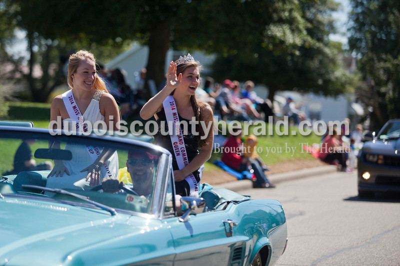 Miss Holland Community Festival Queen Lauren Meyer, 15, right, and First Runner-up Taylor Miles, 18, both of Holland, rode in the Holland Community Festival Parade on Saturday.<br /> Caitlin O'Hara/The Herald