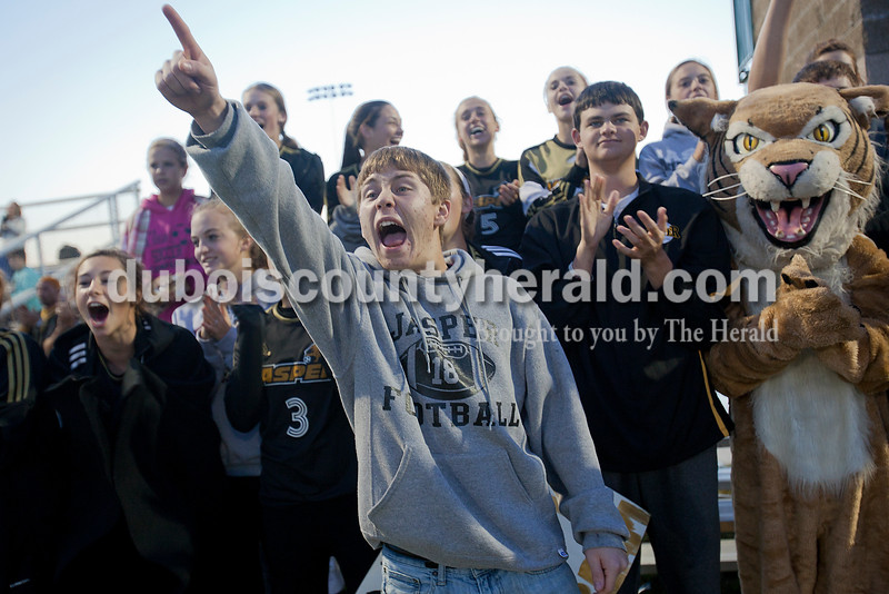 Jasper senior Dillon Hurst screamed out as his brother Caleb Hurst was announced during player introductions at Monday night's IHSSA boys soccer sectional at North High School Soccer Complex in Evansville. Jasper defeated Castle 4-1. Rachel Mummey/The Herald