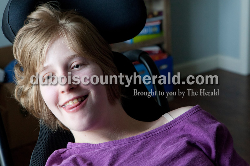 Heather Rousseau/ The Herald<br /> Olivia Lueken, 17, watched Twilight on the computer at her home on Jasper on Monday. Olivia has a rare illness that affects her muscles called Dystonia. She had just gotten home from her physical therapy and loves the Twilight characters who really make her smile.