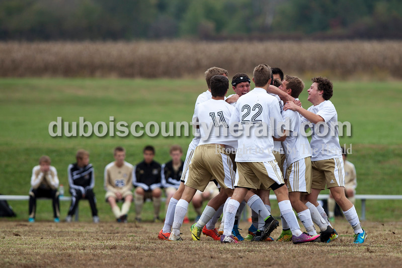 The Wildcats celebrated a goal scored by Jasper's Caleb Hurst during the 2A sectional final Saturday in Evansville. The Wildcats won 3-0. <br /> Caitlin O'Hara/The Herald