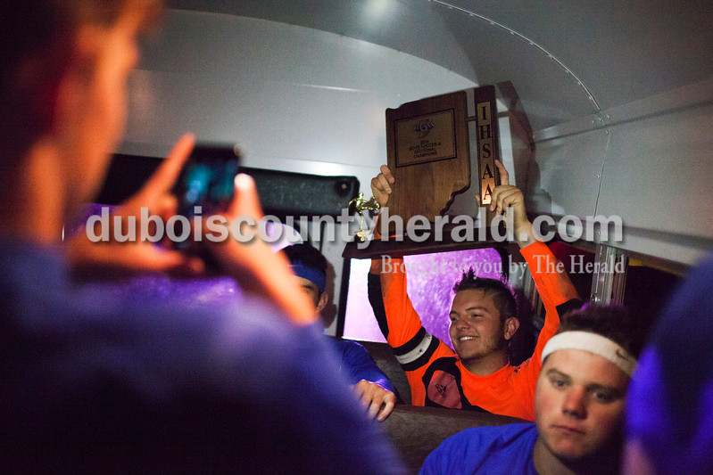 Northeast Dubois' Nolan Rasche posed for a photo with the trophy during a firetruck escort around Dubois and Celestine after winning the 1A sectional final Saturday in Dubois. The Jeeps won 4-2 in penalty kicks after a 2-2 draw through regulation and overtime. It is the first sectional title in program history.<br /> Caitlin O'Hara/The Herald