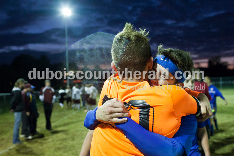 Northeast Dubois' Logan Anderson, right, hugged goalie Nolan Rasche, left, after winning the 1A sectional final Saturday in Dubois. The Jeeps won 4-2 in penalty kicks after a 2-2 draw through regulation and overtime. It is the first sectional title in program history.<br /> Caitlin O'Hara/The Herald