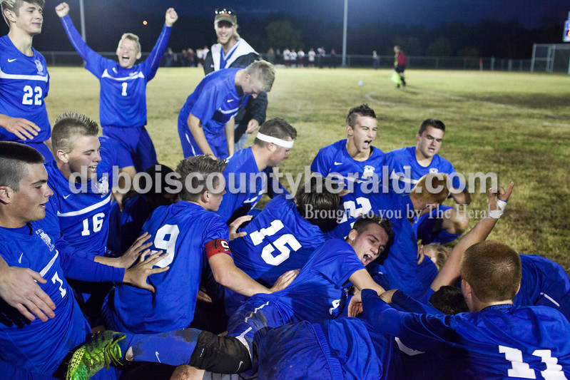 Northeast Dubois celebrated after winning the 1A sectional final Saturday in Dubois. The Jeeps won 4-2 in penalty kicks after a 2-2 draw through regulation and overtime. It is the first sectional title in program history.<br /> Caitlin O'Hara/The Herald