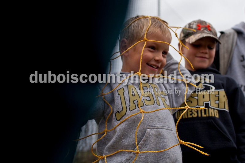 Brothers Drew Gegogeine of Ireland, 4, left, and Mason, 8, right, scored a piece of the goal net after the Wildcats won the 2A sectional final Saturday in Evansville. Coach Kyle Kendall is their uncle.<br /> Caitlin O'Hara/The Herald