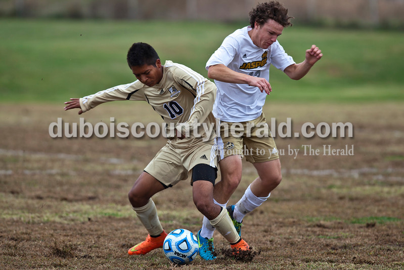 Jasper's Noah Farmer fought Washington's Alex Ruiz for the ball during the 2A sectional final Saturday in Evansville. The Wildcats won 3-0. <br /> Caitlin O'Hara/The Herald