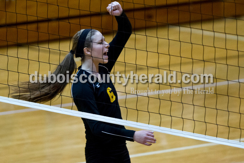 Jasper's Alex Krapf celebrated a point during the sectional Saturday at Vincennes Lincoln. The Wildcats swept the Patriots 3-0.<br /> Caitlin O'Hara/The Herald