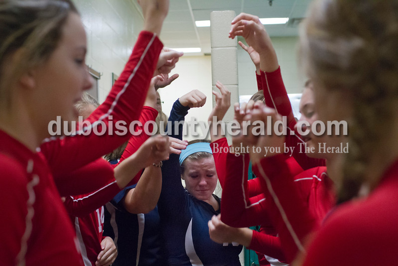 Heritage Hills' Ashley Mosby, center, cried as the Patriots said their last cheer as a team in the locker room after the sectional Saturday at Vincennes Lincoln. The Wildcats swept the Patriots 3-0, knocking them from the tournament for the fourth year in a row and ending their season.<br /> Caitlin O'Hara/The Herald