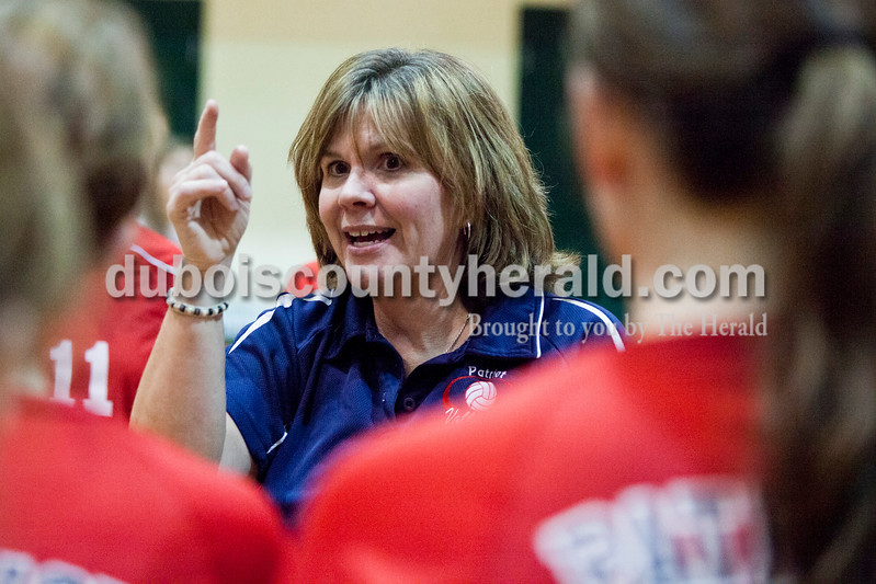 Heritage Hills Head Coach Annie Gunselman addressed her team during a timeout in the sectional Saturday at Vincennes Lincoln. The Wildcats swept the Patriots 3-0.<br /> Caitlin O'Hara/The Herald