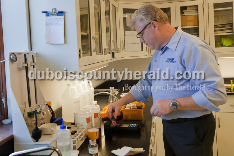 Heather Rousseau/ The Herald<br /> Filtration plant operator, Darin Kemp,  of the Jasper Water Department tested samples for chlorine content. The tests are conducted about every hour when the plant is operating.