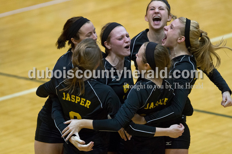 The Jasper squad celebrated a point during the sectional Saturday at Vincennes Lincoln. The Wildcats swept the Patriots 3-0.<br /> Caitlin O'Hara/The Herald