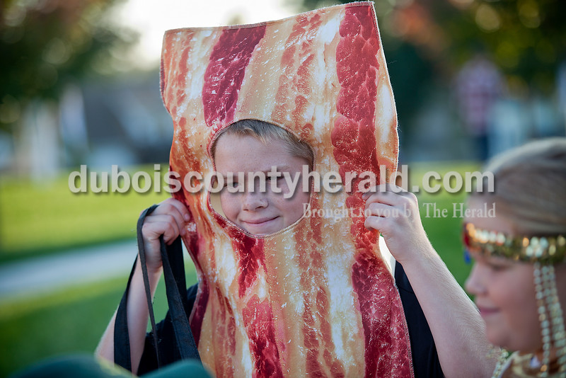 Rachel Mummey/The Herald<br /> Austin Wolf of Jasper, 12, showed off his bacon costume while trick-or-treating with his sister Madison, 9, right, and brother Cameron, 7, not pictured, Sunday during the fourth annual Halloween at Central Green. The Jasper Parks and Recreation Department sponsored the trick-or-treat event which also hosted pumpkin bowling, corn hole, ring toss and other games.