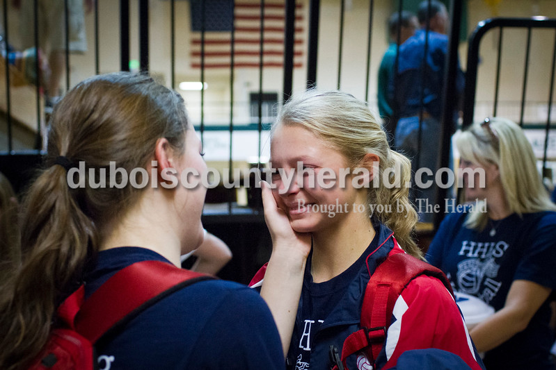 Heritage Hills' senior Miriah Leibering, left, comforted freshman teammate Abby Wetzel as she cried after the sectional Saturday at Vincennes Lincoln. The Wildcats swept the Patriots 3-0, knocking them from the tournament for the fourth year in a row and ending their season.<br /> Caitlin O'Hara/The Herald