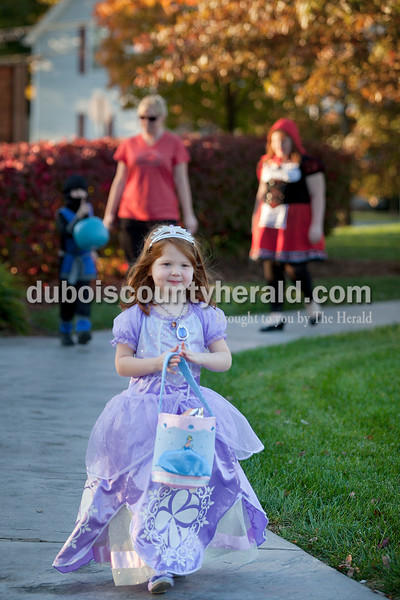 Rachel Mummey/The Herald<br /> Norah Desser of Jasper, 4, toted a bag of candy as she strolled around for candy Sunday during the fourth annual Halloween at Central Green. The Jasper Parks and Recreation Department sponsored the trick-or-treat event which also hosted pumpkin bowling, corn hole, ring toss and other games.