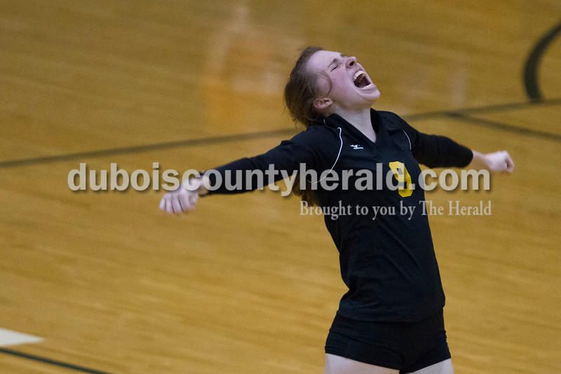 Jasper's Lydia Schmitt celebrated a point during the sectional Saturday at Vincennes Lincoln. The Wildcats swept the Patriots 3-0.<br /> Caitlin O'Hara/The Herald