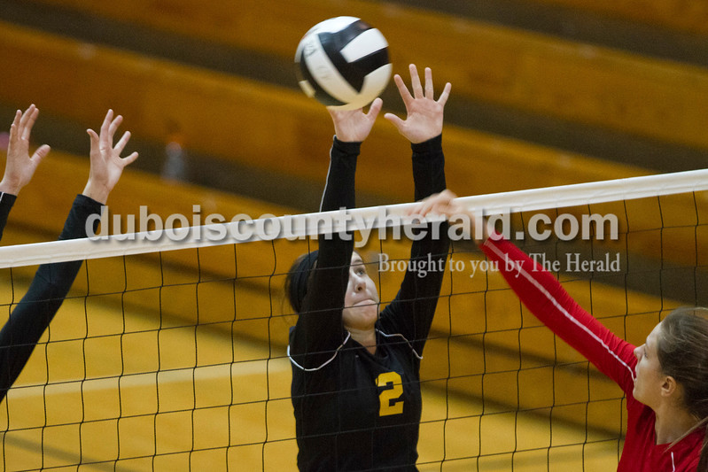 Jasper's Elisabeth Ahlbrand blocked a spike during the sectional Saturday at Vincennes Lincoln. The Wildcats swept the Patriots 3-0.<br /> Caitlin O'Hara/The Herald