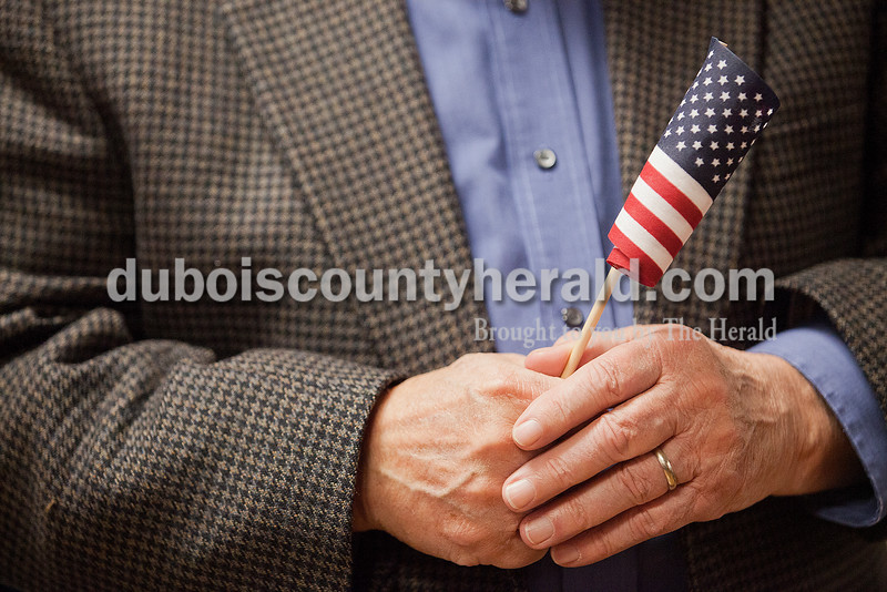 Rev, Gerald Frye held onto an American flag during the Veterans Day service on Tuesday in Jasper. Rachel Mummey/The Herald
