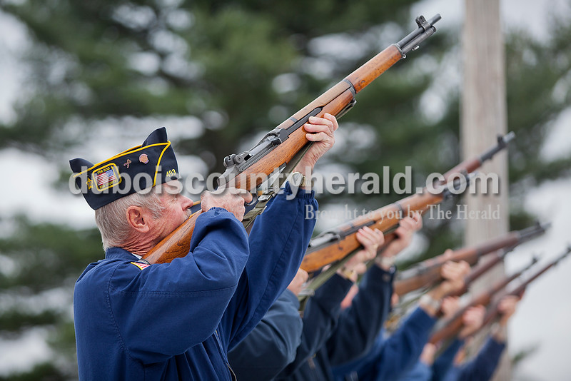 Rachel Mummey/The Herald<br /> Jim Berg of St. Anthony took aim with the rifle squad as the honor guard shot off a 21-gun salute following a ceremony honoring SFC Anthony Hurst of Jasper with this year's Living Veteran Award at the American Legion Post 493 in St. Anthony on Saturday. Berg served with the Army during Vietnam.