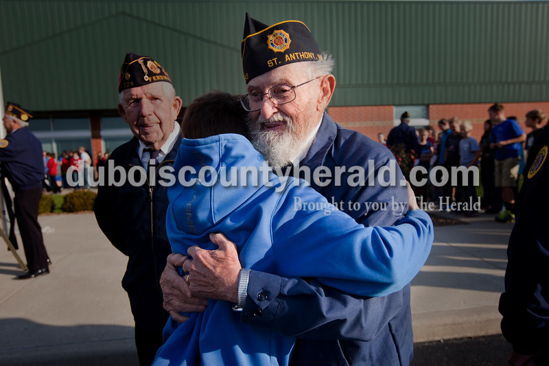 Albert Merkley with the Schnellville  American Legion was hugged by friend and neighbor Wesley Stout a sixth-grader at Cedar Crest Intermediate School after a Veterans Day event hosted by the school in Bretzville this morning. <br /> Heather Rousseau/The Herald