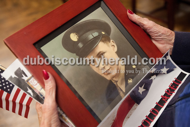 Northwood Retirement Community Kathleen Larue held onto a photograph of her late husband Harold Larue, who served in the U.S. Army during the 1940s, during the Veterans Day service on Tuesday in Jasper.  He died from cancer many years after his service. Rachel Mummey/The Herald