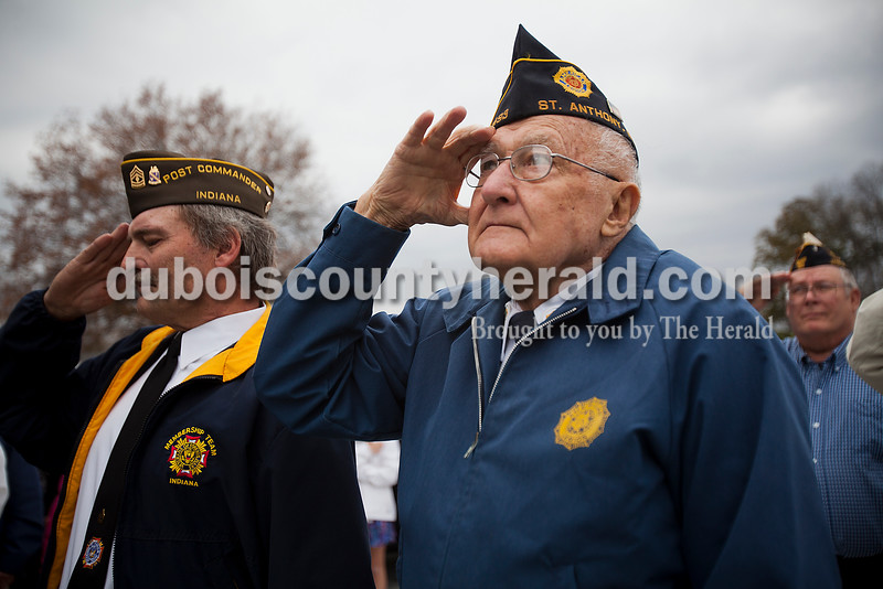 Rachel Mummey/The Herald<br /> Jeff Fromme of Ferdinand, left, Gene Betz of Jasper and Bernand Thewes of Portersville saluted the flag during a playing of taps following a ceremony honoring SFC Anthony Hurst of Jasper with this year's Living Veteran Award at the American Legion Post 493 in St. Anthony on Saturday. Fromme served with the Marines then the Army National Guard. Betz served with the Marines in Japan and Korea. Thewes served with the U.S. Navy in the Mekong Delta during Vietnam.