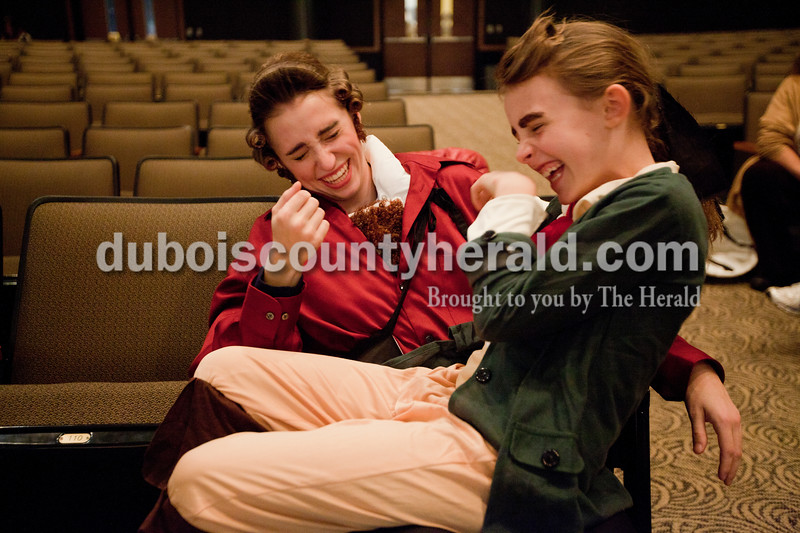 "Heather Rousseau/The Herald<br /> Lauren Hayes, 9, sat on the lap of Priscilla Olson, 15, both of Jasper as they laughed about Olson's fake chest hair for her Gaston costume during The Children's Theatre Project  dress rehearsal of Disney's Beauty and the Beast Jr. at Jasper Middle School in Jasper on Sunday. Shows are on Saturday, November 15 3p.m. and 7p.m. and then Sunday, November 16 at 3p.m. At the Jasper Middle School. Tickets are $6 in advance and $8 at the door. They are available now through Nov. 11 at  <a href=""http://www.tututix.com"">http://www.tututix.com</a> or by calling (855)222-2TIX. More photos are at  <a href=""http://www.DuboisCountyHerald.com"">http://www.DuboisCountyHerald.com</a>."