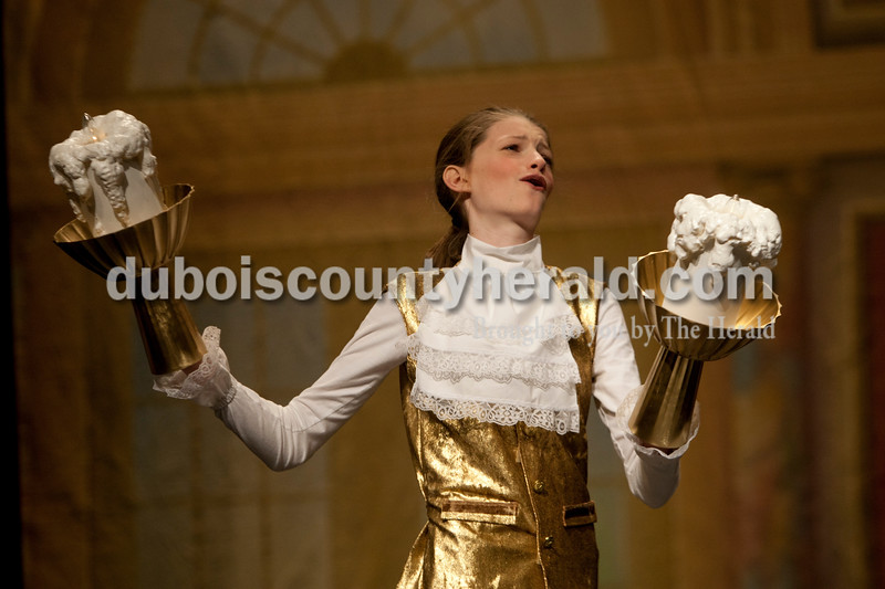 "Heather Rousseau/The Herald<br /> Keely Magee, 12, of Jasper, preformed her character ""Lumiere"" during The Children's Theatre Project  dress rehearsal of Disney's Beauty and the Beast Jr. at Jasper Middle School in Jasper on Sunday. Shows are on Saturday, November 15 3p.m. and 7p.m. and then Sunday, November 16 at 3p.m. At the Jasper Middle School. Tickets are $6 in advance and $8 at the door. They are available now through Nov. 11 at  <a href=""http://www.tututix.com"">http://www.tututix.com</a> or by calling (855)222-2TIX. More photos are at  <a href=""http://www.DuboisCountyHerald.com"">http://www.DuboisCountyHerald.com</a>."