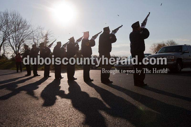 The Ferdinand American Legion post 124 rifle squad fired shots during a Veterans Day event this morning at Cedar Crest Intermediate School in Bretzville.<br /> Heather Rousseau/The Herald