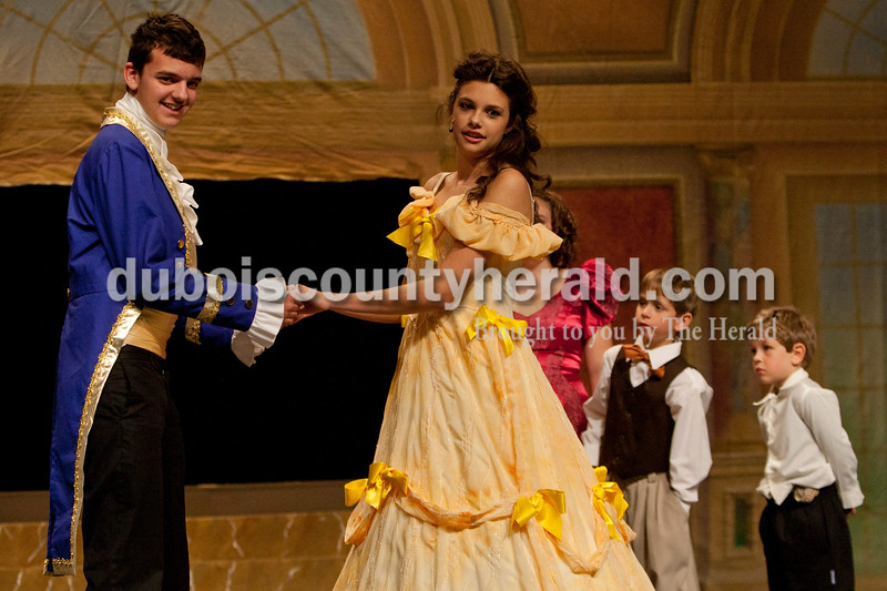 Caleb Mullins, 15, of Monroe City, left, and Kelsey Graman, 18, of Jasper, looked for direction during The Children's Theatre Project  dress rehearsal of Disney's Beauty and the Beast Jr. at Jasper Middle School in Jasper on Sunday. Mullins' character was the prince and the beast and Graman was Bell. Heather Rousseau/The Herald