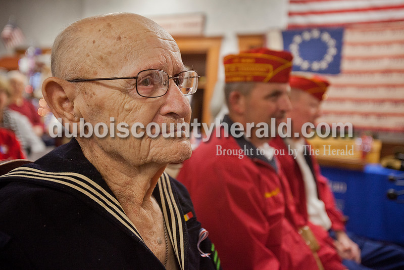 Northwood Retirement Community resident Don Ambrose listened to Jasper High School choir members sing the National Anthem during the Veterans Day service on Tuesday in Jasper. Ambrose wore his original Navy uniform which he wore while serving in the Korean War. Rachel Mummey/The Herald