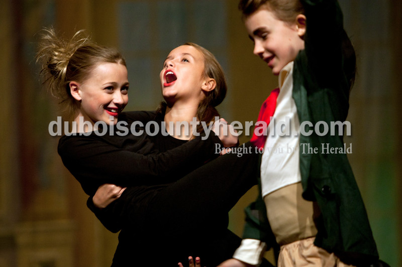 """Heather Rousseau/The Herald<br /> Denni Hilgefort, left, Corbyn Decker, both 10, as Lauren Hayeys, 9, all of Jasper, danced and laughed together between scenes during The Children's Theatre Project  dress rehearsal of Disney's Beauty and the Beast Jr. at Jasper Middle School in Jasper on Sunday. Shows are on Saturday, November 15 3p.m. and 7p.m. and then Sunday, November 16 at 3p.m. At the Jasper Middle School. Tickets are $6 in advance and $8 at the door. They are available now through Nov. 11 at  <a href=""""http://www.tututix.com"""">http://www.tututix.com</a> or by calling (855)222-2TIX. More photos are at  <a href=""""http://www.DuboisCountyHerald.com"""">http://www.DuboisCountyHerald.com</a>."""