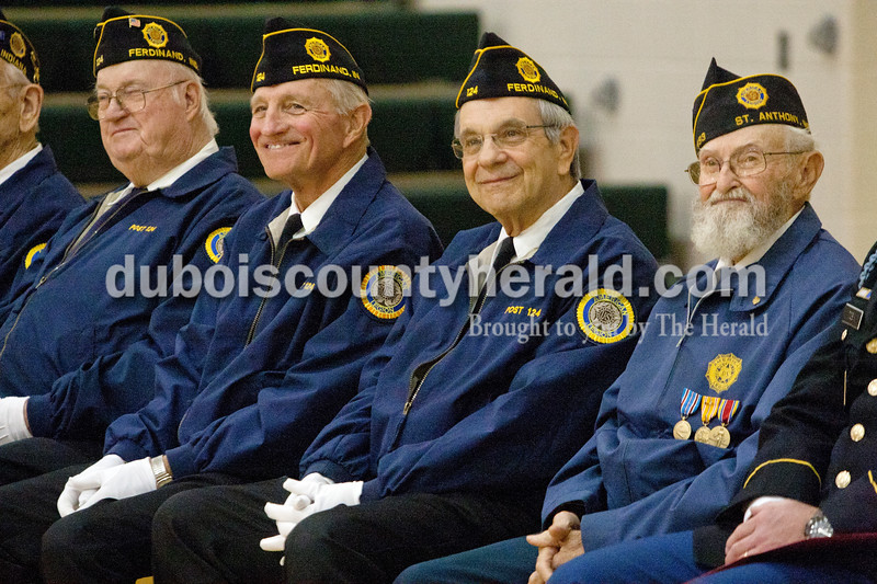 Veterans with  Ferdinand American Legion post 124, from left, Robert Dall, Jim Knust, Larry Hamilton all of Ferdinand, and Albert Merkley with the Schnellville  American Legion listed to a video of students reading poems they wrote for veterans during a Veterans Day event at Cedar Crest Intermediate School in Bretzville this morning.<br /> Heather Rousseau/The Herald