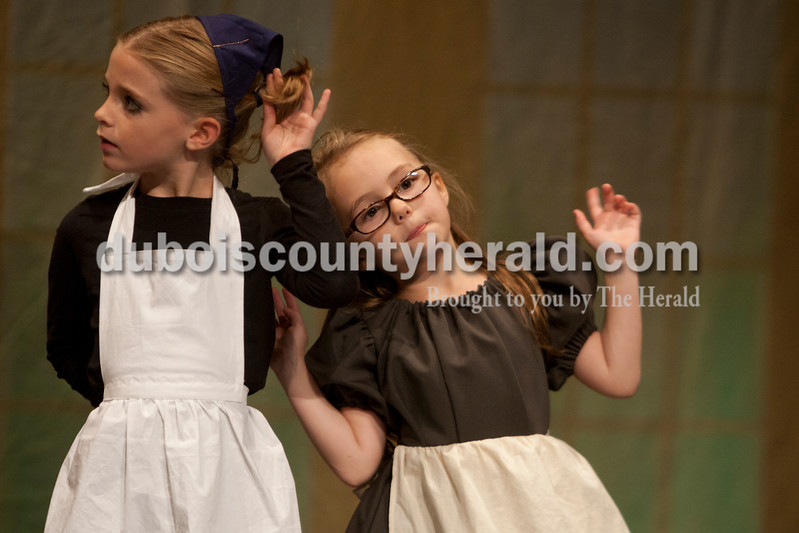 "AzLeigh Barker, 8, left and Zoie Warner, 6, both of Jasper, dressed as ""counts people"" during The Children's Theatre Project  dress rehearsal of Disney's Beauty and the Beast Jr. at Jasper Middle School in Jasper on Sunday."
