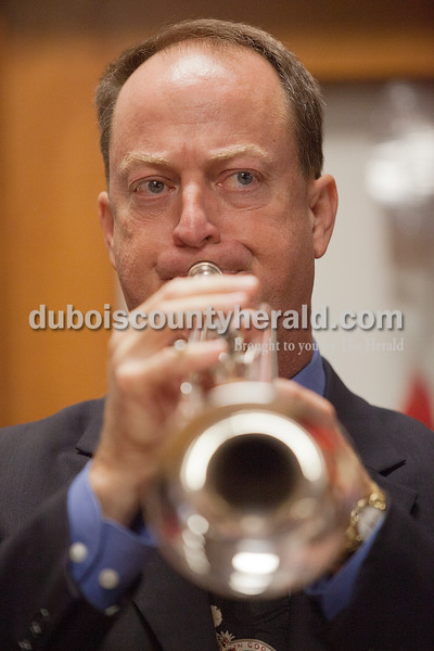 U.S. State Representative Mark Messmer played taps during the Veterans Day service on Tuesday in Jasper. Rachel Mummey/The Herald