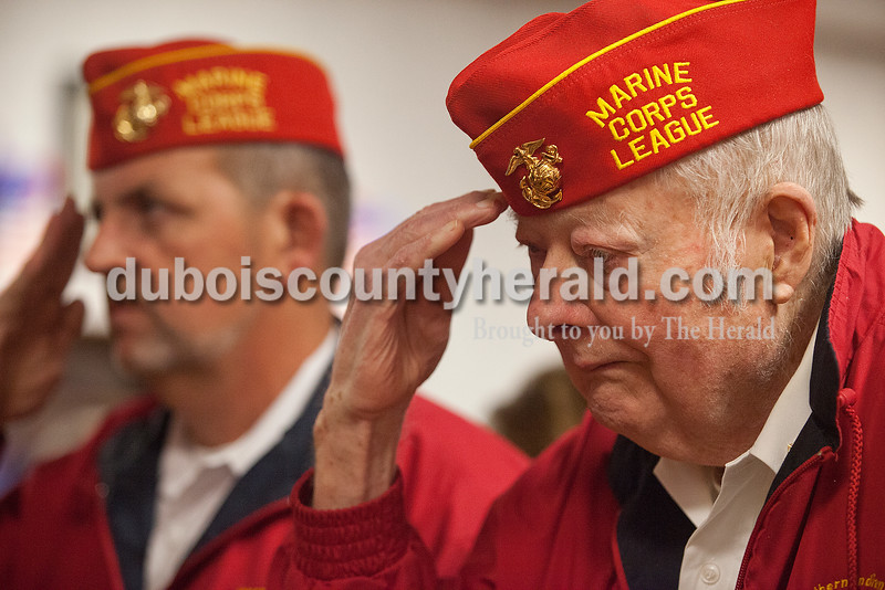 Northwood Retirement Community assisted living resident Don Burton saluted the Pledge of Allegiance was recited during the Veterans Day service on Tuesday in Jasper. Burton served with the Marines. Rachel Mummey/The Herald