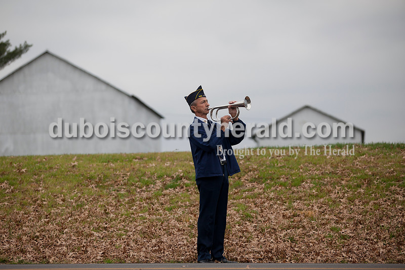 Rachel Mummey/The Herald<br /> Alan Bromm of St. Anthony played taps following a ceremony honoring SFC Anthony Hurst of Jasper with this year's Living Veteran Award at the American Legion Post 493 in St. Anthony on Saturday. Bromm served with the Army National Guard during Vietnam.