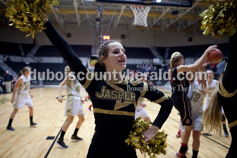 Jasper senior Kiersten Lorey cheered during the game against Southridge on Saturday in Jasper. The Raiders beat the Wildcats 49-47.<br /> Caitlin O'Hara/The Herald