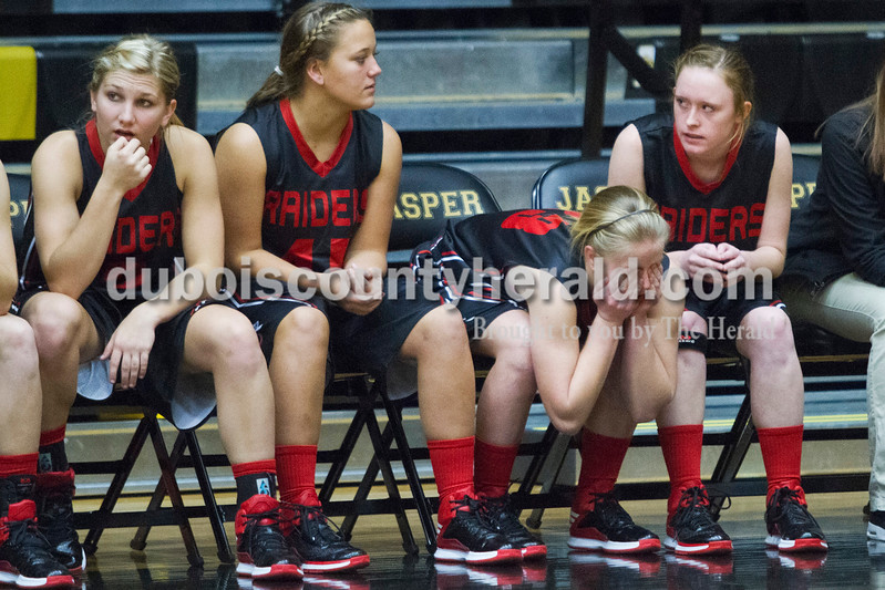 Southridge's Kayla Voegerl, Tori Tretter, Misty Merter and Emily Eckert watched during the last few minutes of game against Saturday in Jasper. The Raiders beat the Wildcats 49-47.<br /> Caitlin O'Hara/The Herald