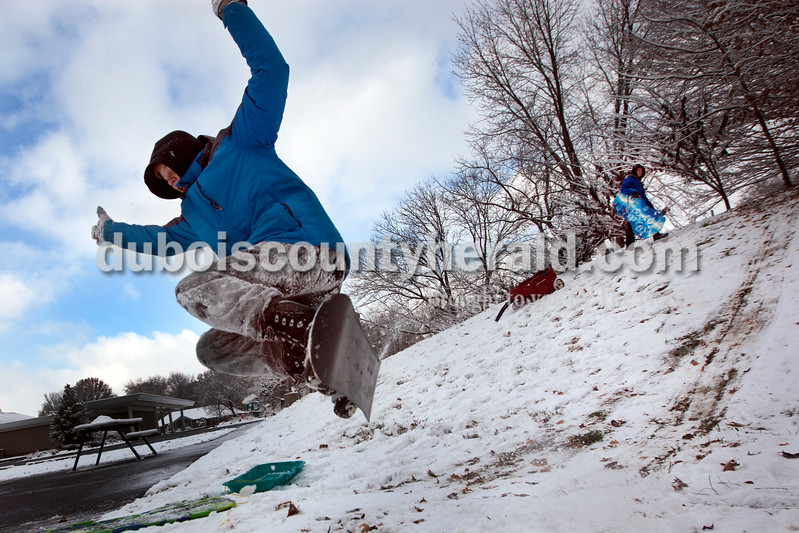 Heather Rousseau/The Herald<br /> Quintin Gordon, 15, caught some air from a jump he made as his brother Dimitry Gordon, 14, approached the top of the hill with his sled while in an open space behind First Presbyterian Church near their home in Jasper this morning. Quintin was glad schools were closed due to snow while Dimitry would have preferred to go to school.