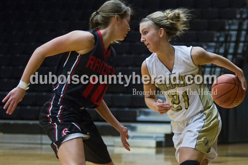 Southridge's Kadie Dearing defended against Jasper's Maddison Ubelhor during the game against Saturday in Jasper. The Raiders beat the Wildcats 49-47.<br /> Caitlin O'Hara/The Herald
